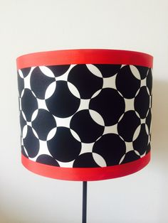 Red trim that pops. 30cm drum shade. Handcrafted by lampelier