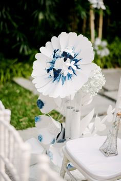 Blue and white paper handcrafted flower decor for wedding aisle // French Flair: Josh and Vivian's Parisian-Themed Wedding at Grand Hyatt