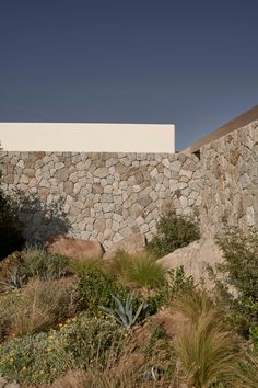 The Greek architecture practice K-Studio has recently completed Villa Mandra, a single-family home located on the hill of Aleomandra in Mykonos, Greece. #villa #mykonos #pool #greece #stone #stonehouse #architecture #architect #amazingarchitecture #design #interiordesign #interiordesigner #decor #homedecor #home #house #luxury #diy #travel #amazing #photography #realestate #casa #arquitecto #arquitectura #decoration #greekisland #aegansea #sea #nature #desert #swimmingpool #houseplan Cabinet D Architecture, Vernacular Architecture, House Architecture, Amazing Architecture, Villa, Tahiti, Wooden Table And Chairs, Studio Build, Wooden Pergola