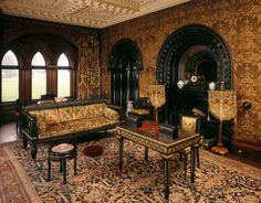 View of The Ebony Room at Penrhyn Castle including the fireplace, desk, carved wooden stool and sofa  ©NTPL/Michael Caldwell