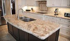 Granite on island.  sienna bordeaux granite