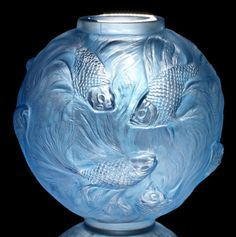 René Lalique  'Formose' a Vase, design 1924  frosted glass, heightened with blue staining  16.8cm high, moulded 'R. Lalique'