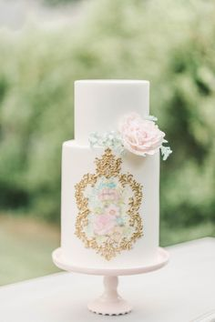 Antique inspired hand-painted wedding cake.