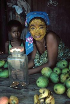 MADAGASCAR. Island of Nosy Be. A woman wearing the yellow face powder that is a traditional body View information