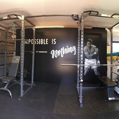 """A commissioned piece for a private gym of a hand stencilled and spray painted Muhammed Ali, with the word """"Impossible is Nothing"""" spray painted. Ali, Stencils, Neon Signs, Words, Ant, Templates, Stenciling, Horse, Painting Stencils"""