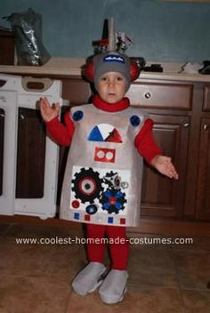 Homemade Robot Kid Costume Idea: My 3year old originally wanted to be a dinosaur, he loves dinosaurs but since we did a dragon 2 years ago and the fact that we live in Florida and it is