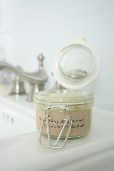 Renew your skin with this DIY Rosemary Mint Sugar Scrub made in your kitchen with just a few ingredients!  Great gift idea via www.julieblanner.com