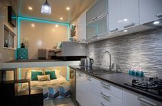 Kitchen Living Room and Bedroom. Tiny House Minimalist and Space Age Architecture. By Absolute Tiny Houses.