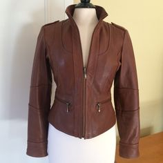 Wow! Kenneth Cole Reaction Leather Jacket Butter soft! Like-new Kenneth Cole reaction leather jacket with zip front. Excellent construction. Two zip front pockets and beautiful bodice and shoulder seaming. Sleeve cuffs can be worn up or down; the cuffs have both a zipper and snap. Cute epaulet detail.  Beautiful leather and fully lined. Tiny color loss dot on back; see top of 4th photo. Stunning jacket. Size S. Kenneth Cole Reaction Jackets & Coats