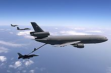 McGuire AFB KC-10 Extender refueling a F-16 Fighting Falcon with a F-15 Eagle and another F-16 to the side.