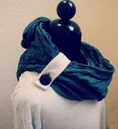 Supplies: Crew neck shirt. Get 2 if you want the cowl to match. Buttons. You can also use other fabrics for the straps. I want to d...