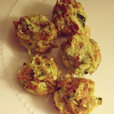 IP Zucchini Tots 1 c. Zucchini, Grated 1  Egg ¼ c. shaved cauliflower 1 IP packet of Garlic & Herb Chips (crushed) Sliced green onion Salt/Pepper/Spices Add crumbled/chopped lean meats as  1. Preheat oven to 400ºF. Spray a mini-muffin tin with nonstick spray, set aside. 2. Grate the zucchini. Place it in a dish towel & squeeze out the excess water 3. Combine ingredients 4. Fill the muffin cups to the top. 5. Spray tops of tots with nonstick spray  6. Bake for 15-18 minutes
