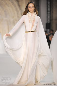 Ivory silk jersey and organza draped dress, silk crepe and organza layered dress with long sleeves.  Haute Couture Autumn/Winter 2012-13 Stephen Rolland