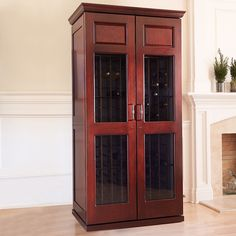 Our elegant Carolina 2400 wine cabinet holds 286 bottles while maintaining optimal temperature and humidity for aging your wine collection. Wine Cabinets, Storage Cabinets, Tall Cabinet Storage, Wine Cabinet Furniture, Cooling Unit, Country Interior Design, Base Moulding, Wine Collection, Cherry Finish