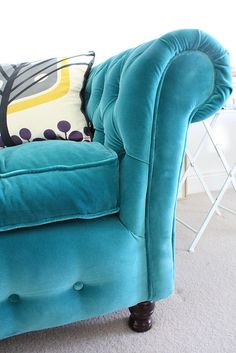 tufted turquoise velvet sofa detail