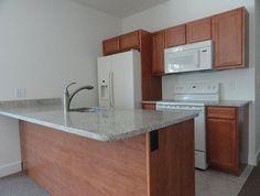 Kitchen at 3337-43 Spring Garden Street. Granite counters, new appliances. www.universityrealtyapartments.com