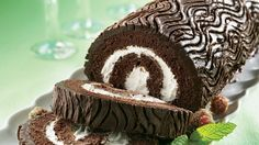 An impressive chocolate cake roll filled with creamy vanilla frosting will keep the home fires burning throughout the holiday season!
