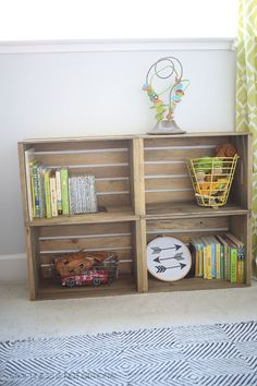 Peter Pan Baby Boy Nursery Stained unfinished storage crates and screwed them together.
