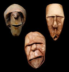 Mom I can totally see you making these toilet paper roll faces and spray painting them gold or something.  Be real cool in your mexican house!
