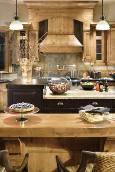 kitchen snack bar ideas | Kitchen features two islands, built-in wine cooler and much more.