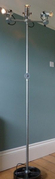 Theatre style triple spot floor lamp. Hand crafted from galvanised conduit, with a cast iron wheel base. Three adjustable spotlamps. £329.99.