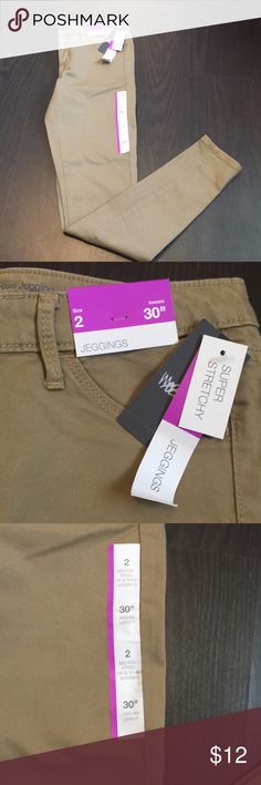 Khaki Jeans from Mossimo Size 2 NWT Khaki/Tan Skinny Jeans from Mossimo. No stains or rips. Were just sitting in my closet and never wore them. Stretchy material Mossimo Supply Co. Jeans Skinny