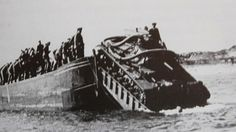 Practice for Operation Sealion:  a Tauchpanzer submersible tank drives off a landing craft onto a beach at Hörnum on the island of Sylt, off the German North Sea coast.