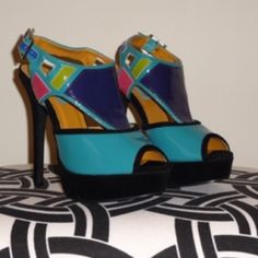 Sandals These hot sandals are designed with multicolored patent leather. With a black faux suede platform heel, these shoes will work with lots of outfits! Brass Candy Shoes Sandals