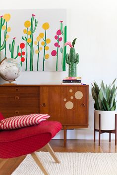 Mid-century wood console and all the cacti!