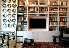 Scott Leaves the Suburbs Behind. Bookshelves and Kitchen Cabinets: designed by Scott manufactured by Craftline Cabinets