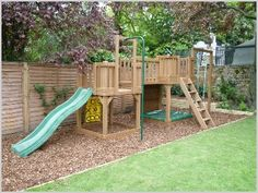 Spacious childrens play area with soft bark chip flooring for