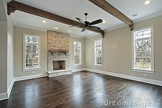 Family room with ceiling wood beams by Lmphot, via Dreamstime