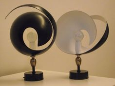 'Flamme' lamps by Serge Mouille. #vintage