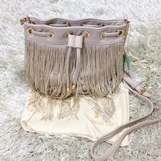 "Deux Lux Fringe Crossbody Bag Buttery soft faux Deux Lux Fringe Crossbody Bag. Long, swingy fringe adds a boho vibe with a magnetic snap closure. Drawstring-cinched. Interior has zip pocket. 7"" H x 7"" W x 4"" D. Approximately 19""-24"" crossbody strap drop. Feel free to ask questions!  Deux Lux Bags"