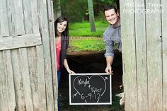 cute-engaement-pictures-in-barn-with-chalk boards-north carolina-photography