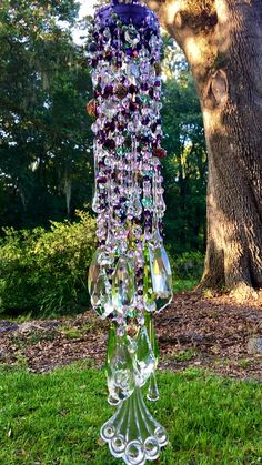 Draped in Lush Strands of Cloisonné Antique Crystal Wind Chimes, Diy Wind Chimes, Hanging Crystals, Diy Crystals, Garden Crafts, Garden Art, Homemade Garden Decorations, Garden Whimsy, Christmas Swags