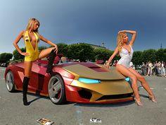 OMG iron man car YAY!!! and beautifull chicks LOL :P = AWESUMMMHH