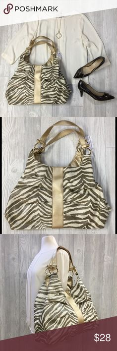 """Zebra Pattern Shoulder Bag Zebra Pattern Shoulder Bag, Mocha, Ivory & Gold w/ Semi Sheen Exterior, Gold Hardware, Two Large Storage Compartments on the Interior w/ a Smaller Compartment that Zips in the Center as Shown in Last Photo, Interior Zip Pouch for Coinage, Snap Closure, Lightweight, 17""""L x 6""""W x 22""""H Including Handles, Brand New, Unused Christopher & Banks Bags Shoulder Bags"""