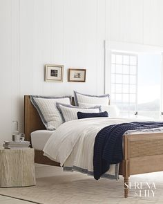 We love the textural knitting of this navy blue throw. Not only is it invitingly cozy, but it works beautifully with the blue and white bedding in this simple bedroom. White Bedding, Bedding Sets, Gray Comforter, Quilt Bedding, Master Bedroom, Bedroom Decor, Bedroom Ideas, Bed Ideas, White Bedroom