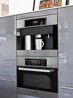 Sleek, efficient, and ready-to-serve, a built-in coffeemaker reflects the same contemporary spirit as adjacent lacquer cabinets. Setting a coffee-making operation above or below a microwave optimizes a kitchen's vertical space and improves its overall function./