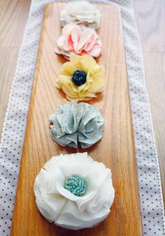 No sew fabric flower tutorial. I saw a picture of this type of fabric flowers glued to clothespins to dress them up a bit...  It looked great!