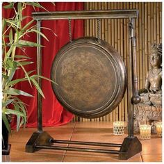 A sharp staccato sound with long lasting shimmer is the reward for touching beater to metal on this traditional, suspended Chinese gong. Two feet of authentic, quality metal with an antique finish is Feng Shui, Oriental Furniture, Japanese Furniture, Chinese Furniture, Street Gallery, Asian Design, Asian Decor, Parasol, China