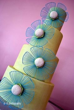 blue string flowers on key lime colored cake