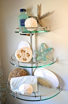 "Pottery Barn round glass bathroom shelf. From Pottery Barn's blog post entitled, ""A Coastal-Inspired Bath, With Nautical (DIYed!) Wallpaper""."