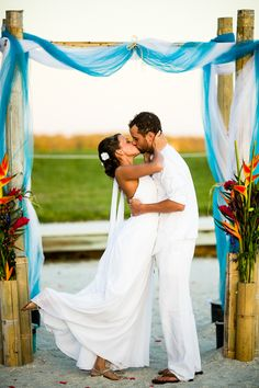 tropical wedding ceremony... arch + flowers (flowers match the bouquet, decor, & hairpiece)
