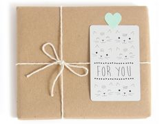 """very simple and very cute gift wrap with brown kraft paper wrap, yarn and a """"for you"""" tag with kittens!"""
