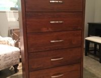 5 Drawer chest built in western maple with a coco stain. The squared brush nickel handles add a modern feel.