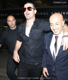 Robin Thicke  arrives at Los Angeles International (LAX) airport http://icelebz.com/events/robin_thicke_arrives_at_los_angeles_international_lax_airport/photo1.html