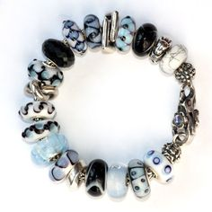 Lovely combination of light blues with greys and blacks. Many of the beads are unique beads.