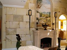 Wall mural and faux stone finish.